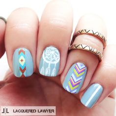 Bohemian nail art with decals and hand-painted designs.