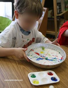 Marble Painting  Children place a piece of paper in a pie pan, dip a marble in paint and roll it around the pan.