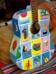 Lotteria guitar!! Coming from a Mexican culture this is a really cool thing to see. A game and a musical instrument in one. :)