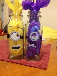 My minion craft!!!  They will either be balloon holders/weights or I'll make them into cupcake stands.  Glass milk bottles; faces painted with oil based sharpies; tissue paper stuffed for color