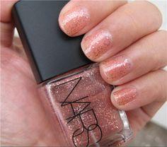 NARS Arabesque nail lacquer (a fun pink glitter polish with a clear base)