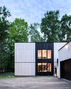 Brooklyn studio AlexAllen has entirely revamped a family home in New York State, trading its outdated plywood siding for a modern finish composed of cement panels and blackened timber. Cement House, Exterior Wall Cladding, Plywood Siding, Insulated Panels, New Paltz, New York Homes, Weekend House, Metal Buildings, Architecture Details