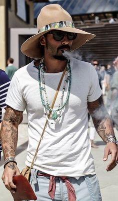 Love the style, love them beads, I couldn't rock that hat though. He's doing alright. : ) | Raddest Looks On The Internet: http://www.raddestlooks.net