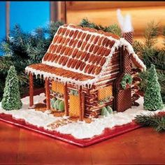Pretzel Log Cabin Recipe, instead of a gingerbread house. Christmas Goodies, Christmas Treats, Christmas Baking, All Things Christmas, Christmas Holidays, Christmas Decorations, Holiday Baking, Christmas Gingerbread House, Gingerbread Houses