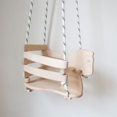 This beautiful wooden horse swing is timeless- hang in the garden or in a child's bedroom. It looks lovely with one of our white sheepskins. The wooden swing is perfect for little ones aged 6 months or when able to sit up independently. As your child grows remove the sides and the swing can be used up to approximately 7 years old.