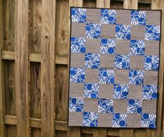 Quilt Story:  Modern baby boy quilt with cobalt blue and black & white chevron.  Simple squares and four patches.  Measurements given in the blog post. Quilt is in the shop! :)