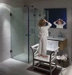 Very functional bathroom: a touchless faucet called Oras Cubista on the wash basin and clear shower cabin with Oras Hydra shower and Oras Cubista concealed thermostatic mixer.