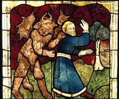 York Minster - panel from the St. William window, showing a man being seized by a devil. The St William Window is one of the most important pieces of medieval stained glass in the world. It is apporoximately 24 metres high and 4.88 metres wide (approx 72 x 14 feet).