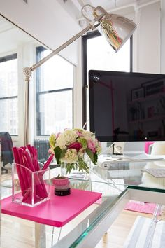 """I love how we worked with the white and glass of the office to benefit the pops of pink that was used throughout the space,"" says Matthew."