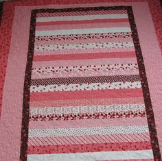 Strip quilt. What a great use of Valentine's Day fabric that doesn't look holidayish.