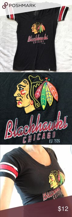 Chicago Blackhawks T shirt Perfect condition! Black tee shirt with stitched-on Blackhawks logo patch and screen printed text. I love this team but have learned my fan style is pretty exclusively jerseys--I never wore this shirt! Size is medium but in my opinion it fits pretty slim. See pics of me modeling it in my usually-size-M-but-post-baby-bod. Bundle with other Blackhawks T for a deal! Tops Tees - Short Sleeve