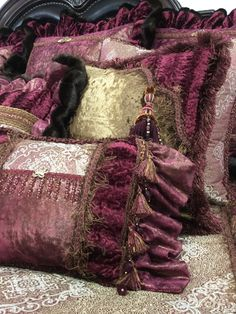 The Isabella Luxury Bedding by Reilly-Chance Collection combines several shades of raspberry silk and chenille with a deep bronze velvet for a sumptuous look!   The pillows are adorned with beads, ,tassel fringe, ruffles and Swarovski Crystal covered embellishments. These pillows are even more Gorgeous in person!   Our over sized bedding is designed to fit the larger beds of today with ample drop on both the duvet and the dust skirt.