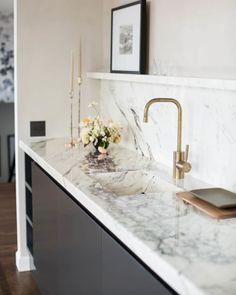 Minimal kitchen sink with marble slab backsplash and burnished brass faucet on Thou Swell While home decor trends are always a bit subjective, I love looking out for movements in the design world from experiences like High Point and my Best Kitchen Design, Kitchen Tiles Design, Kitchen Backsplash, Kitchen Countertops, Backsplash Ideas, Backsplash Marble, Kitchen Sinks, Kitchen Appliances, Minimal Kitchen