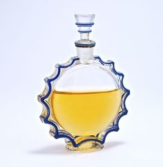1944 R. Lalique,Worth Requete perfume bottle and stopper, clear glass, blue enamel detail. Lalique mark. 3 1/2 in.