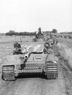 """mavitpzv: """" A column of Panzer VI """"Tiger"""" early version, most likely belonging to the schwere Panzerabteilung 505 (Heavy Battalion 505) tank, at Kursk in July 1943. """""""