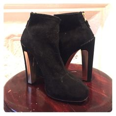 Brian Atwood bootie Brian Atwood black suede bootie with gold detailing on the heel. In beautiful condition Brian Atwood Shoes Ankle Boots & Booties