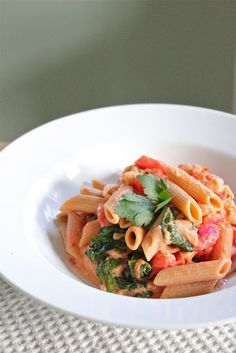 pasta with creamy tomato sauce and spinach.  easy recipe to increase variety of go-to pasta dishes :)