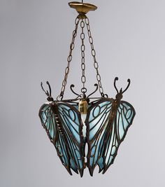Vienna (attributed) 'Butterflies' ceiling light, c1912. Bronze, patina, opal blue glass. Not signed. (hva)