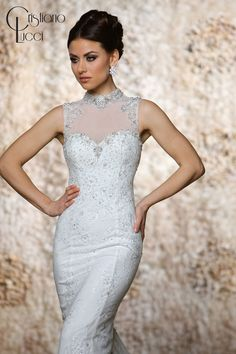 12945/Tia This gorgeous slim A line lace gown combine traditional and modern romance features Mandarin collar and accented with intricate crystal embellishment Fabric: Lace+Tulle Available Color: Ivory, White