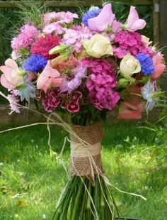 Handtied bouquet with sweetwilliams, sweetpeas, nigella, pink and blue cornflowers and pink roses