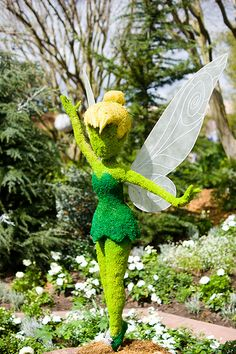 Pixie Hollow Fairy Garden// I'd like to make one of these for the yard!