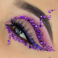 Purple Eyeshadow With Glittery Eyeliner and Rhinestones