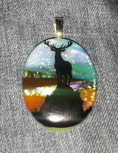 "February 8th: ""The king"" fused glass pendant."