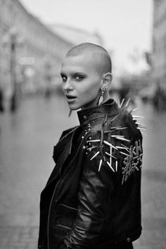 Rebellious style. Leather jacket with spike studs.
