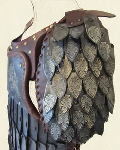 scale pauldrons on leather armour