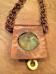 Roofing copper hand sawed with vintage button in cut out. (necklace)