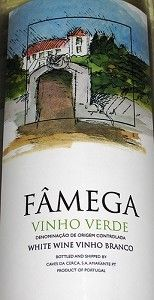 Famega Wine.  Vinho verde, light, fizzy from Portugal.  Said to be the perfect Summer wine.  @ $5.99 Im game!