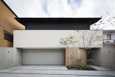 Fushimi House is a minimalist house designed by Den Nen Architecture. The residence features a mute and windowless exterior facade with the natural lighting streaming through the panoramic windows facing the interior courtyard. http://leibal.com/architecture/fushimi-house/