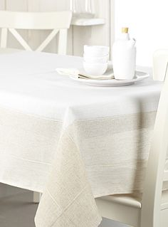 Exclusively from Simons Maison   Elegant pure white accentuated by a wide textured border with discrete openwork for a chic, rustic natural linen look.   - Sophisticated and refined tablecloth, perfect for entertaining  - Easy-care polyester weave, machine wash and dry  - Matching napkin also available