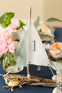 Driftwood sailboats complement the seaside décor for a nautical or beach wedding.