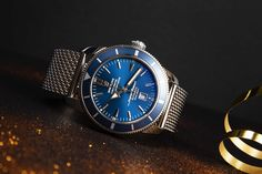 Confortable, elegant, and timeless the Breitling Super Ocean Heritage Ref.46 A1732016-C734-152A will be amazing at your wrist on the beach and anywhere else for this matter.  Its blue bezel and dial reminds us of the ocean and the watch is waterproof up to 200 m. Making this model the coolest for holidays under the sun! Breitling Superocean Heritage, Breitling Watches, Luxury Watches, Chronograph, Omega Watch, Sun, Holidays, Elegant, Amazing