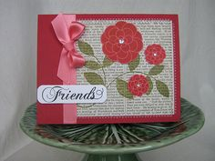 Jan Bloghop Card by Nerina's Cards, via Flickr - love the idea of stamping on book pages