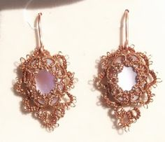 """Pink       These Tatsmithed earrings are made with a pink, muscle shell cabochon.  They were made with two strands of metallic copper, Gutermann thread.  These earrings are 3/4"""" X 1"""".  More Tatsmithing can be found on my FaceBook Page:  West Pine Creations"""