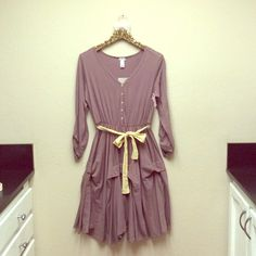 NWT Boutique hippie dress women's size XL Just reduced by $10! This dress is a gray/brown color with a yellow belt. It is slouchy and hits about knee length on most. Super cute, brand is Downeast. downeast Dresses