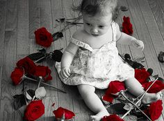Baby surrounded by roses