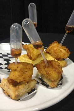 Chicken and waffles with maple syrup in pipettes