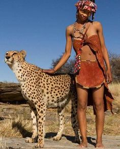 Interaction with a Habituated Cheetah. Photo by In Africa, conflicts between people and wildlife often happen, resulting in young animals having to be taken into sanctuaries in order. African States, African Tribes, African Women, African Nations, Black Women Art, Beautiful Black Women, Beautiful People, Tribal People, Tribal Women