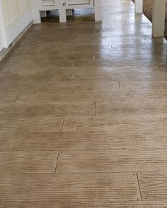Concrete can be an economical and crafty choice in lieu of salvaged wood flooring. Stamping wet concrete with plank-like wood-grain imprints...