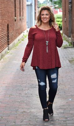 """This pretty burgundy top has such a flattering fit! This is a great piece for your fall and winter wardrobe. It is a ribbed knit, so it will keep you warm without being too heavy or thick! It is long enough for leggings, but would also be cute paired with your fave skinny jeans & boots! Material: 60%cotton 40%polyester.Wash: Gentle wash cold, hang to dry.Fit guide: Runs true to size; Model is 5'7"""", wearing a size medium"""