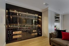 Wine Wall with Sliding Doors Detail London Cellar Maison are specialists in creating bespoke, climate controlled wine cellars and wine rooms tailored to suit your property, interior design, style and wine collection. Caves, Wine Cellar Basement, Home Wine Cellars, Wine Cellar Design, Wine Glass Rack, Wall Wine Racks, Wine Table, Wine Decor, Wine Cabinets