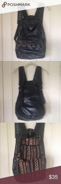 LeSportsac Backpack Joy Rich Design Black Shimmer Backpack. Joy Rich Design. Zipper Pouch in Front. Adjustable Straps. 16x12. Little wear on straps. Lesportsac Bags Backpacks
