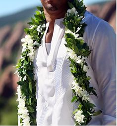 LEI FOR GROOM: James is the only man wearing a lei or flowers. Want the maile lei to have the white, little orchids intertwined with the green vines.