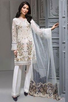 Cast a spell with this white chiffon trouser suit which comprises delightful traditional look. This round neck and full sleeve party wear suit accentuated with thread, sequins and patch work. Teamed up with santoon straight pants in white color and white net dupatta. Straight pant is plain. #trousersuit #salwarkameez #malaysia #Indianwear #Indiandresses #andaazfashion