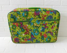 Vintage Butterfly Suitcase  Measures 20 inches in length, 14 1/2 inches wide, and 5 inches in height
