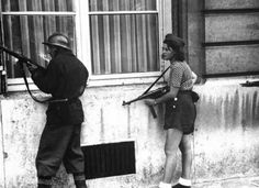 Simone Segouin, 18 yr old French Resistance fighter, 1944.  Her war name was Nicole Minet.  She had come from Chartres to help liberate Paris.
