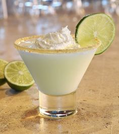 Key Lime Pie Martini~ 1.5 oz vodka, 1.5 Malibu Rum, 0.5 oz lime juice syrup, ice cubes & lime slice